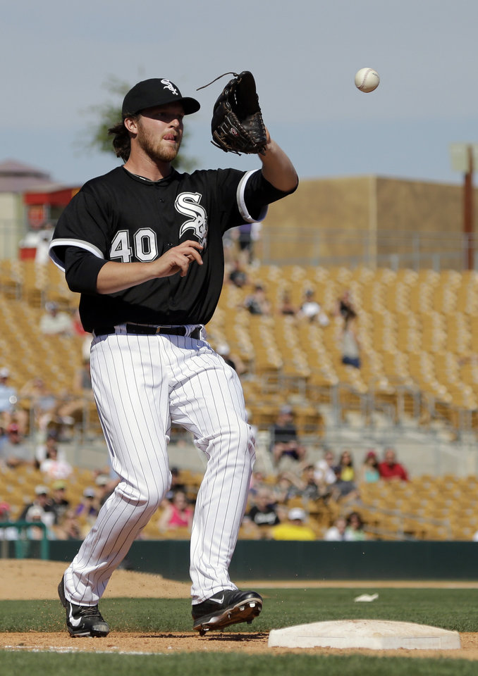 Photo - Chicago White Sox relief pitcher Daniel Webb takes the throw at first to get Colorado Rockies' Charlie Blackmon out in the seventh inning of a spring exhibition baseball game Tuesday, March 25, 2014, in Glendale, Ariz. (AP Photo/Mark Duncan)