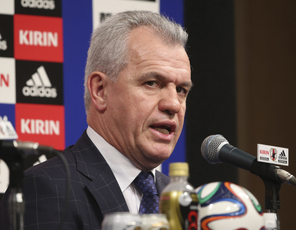 Photo - Japan's new soccer coach Javier Aguirre speaks during a press conference in Tokyo, Monday, Aug. 11, 2014. The 55-year-old Aguirre will take the reins for the Japanese side, with his first match at the helm starting with a friendly against Uruguay at Sapporo Dome on Sept. 5. (AP Photo/Koji Sasahara)