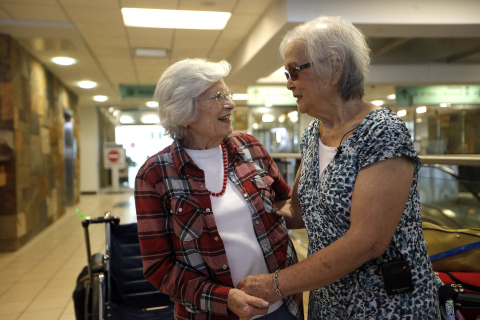 Photo - Sadie Fanali and Lorraine Thomas meet for the first time at Will Roger World Airport, Friday, June 14, 2013, in Oklahoma City.  The pair have been pen pals since 1932. Photo by Sarah Phipps, The Oklahoman