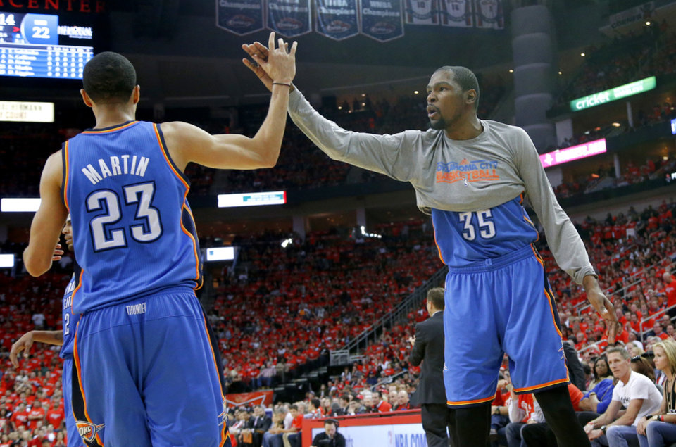 Oklahoma City's Kevin Durant (35) celebrates with /ok23n/ during Game 6 in the first round of the NBA playoffs between the Oklahoma City Thunder and the Houston Rockets at the Toyota Center in Houston, Texas, Friday, May 3, 2013. Oklahoma City won 103-94. Photo by Bryan Terry, The Oklahoman