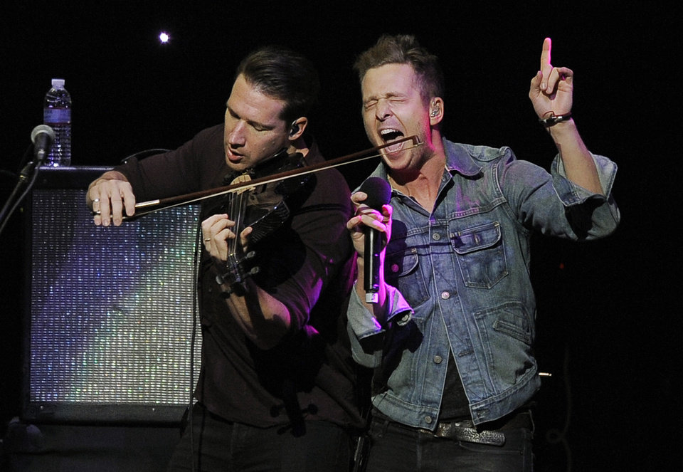 Photo - FILE - In this Dec. 1, 2012 file photo, Zach Filkins, left, and Ryan Tedder of the band OneRepublic perform at KIIS FM's Jingle Ball at Nokia Theatre LA Live  in Los Angeles. (Photo by Chris Pizzello/Invision/AP)