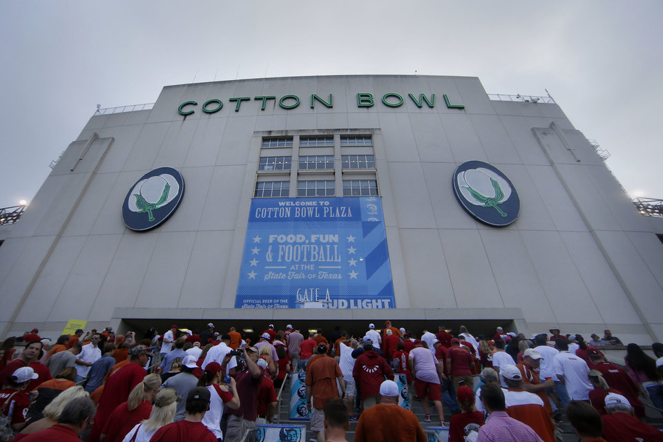 Photo -  Fans file into Cotton Bowl Stadium in Dallas before Texas' 48-45 win against Oklahoma on Oct. 6. [AP FILE PHOTO]
