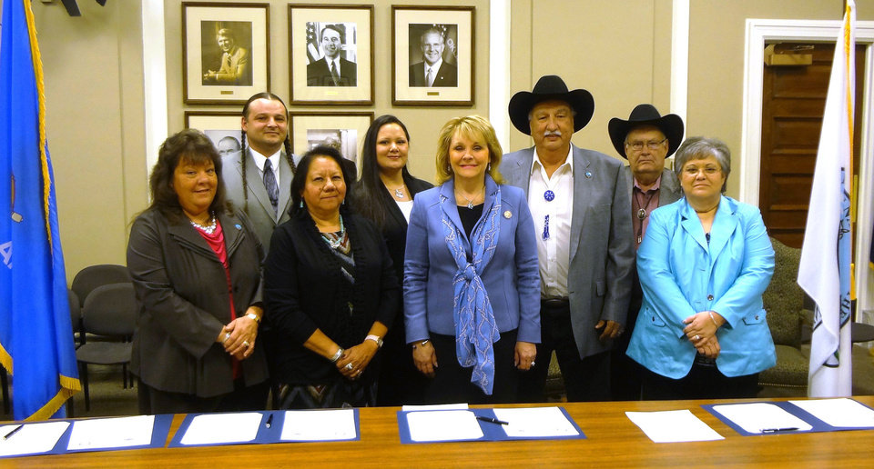 Gov. Mary Fallin and Kaw Nation Chairman Guy Munroe and members of the Kaw Nation\'s tribal council pose for a picture Monday after signing burn ban and tobacco compacts between the state of Oklahoma and the tribe. PROVIDED - PROVIDED
