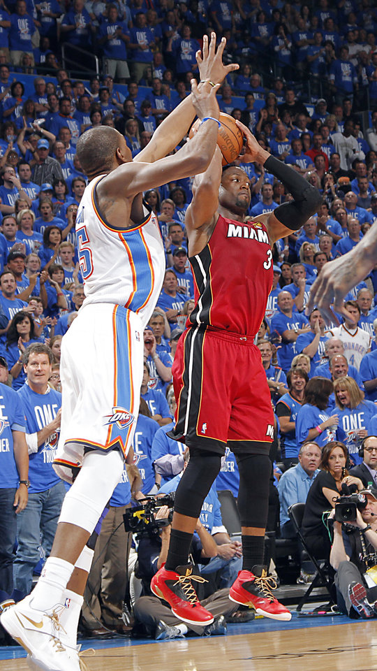 Oklahoma City's Kevin Durant (35) defends on Miami's Dwyane Wade (3) during Game 1 of the NBA Finals between the Oklahoma City Thunder and the Miami Heat at Chesapeake Energy Arena in Oklahoma City, Tuesday, June 12, 2012. Photo by Chris Landsberger, The Oklahoman