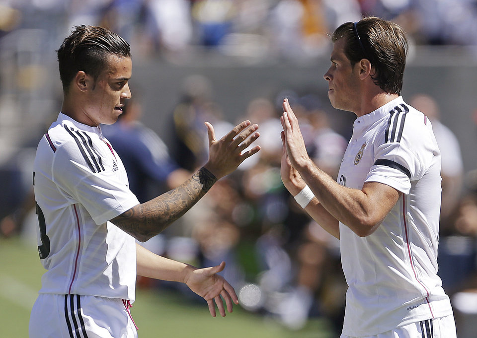 Photo - Real Madrid's Gareth Bale, right, celebrates after scoring a goal against Inter Milan with Raul De Tomas during the first half of a soccer match in the first round of the Guinness International Champions Cup, Saturday, July 26, 2014, in Berkeley, Calif. (AP Photo/Ben Margot)
