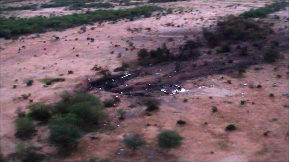 Photo - This photo provided Friday, July 25, 2014 by the French army shows the site of the plane crash in Mali. French soldiers secured a black box from the Air Algerie wreckage site in a desolate region of restive northern Mali on Friday, the French president said. Terrorism hasn't been ruled out as a cause, although officials say the most likely reason for the catastrophe that killed all onboard is bad weather. At least 116 people were killed in Thursday's disaster, nearly half of whom were French. (AP Photo/ECPAD)