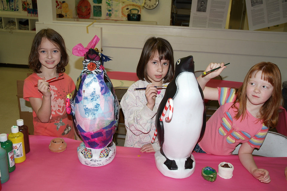 Katie Prior, Megan Ory and Rachel Green were busy at Studio Mid-Del painting Penguins in preparation for Penguins on Parade scheduled for April 28 from 1 to 4 p.m. at the Joe B. Barnes Regional Park at the corner of Reno and Douglas Blvd. in Midwest City. Artists Junior Freeman and Patrick Riley will be available on Thursday, April 5, from 6:30 to 9 p.m. at Studio Mid-Del, 5900 Short Street, Midwest City for the �Decorate a Penguin� Workshop. This workshop is for those individuals who want to try their hand at decorating a fiberglass penguin; but are afraid to try it. The artists will show everyone how to cut, mold, add appendages and all sorts of neat ideas. This activity should be fun for any age and is a great family opportunity. You<br/><b>Community Photo By:</b> Liz Hames<br/><b>Submitted By:</b> Donna, Choctaw