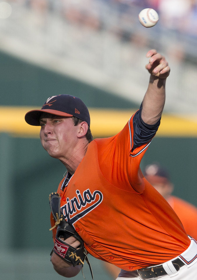 Photo - Virginia pitcher Brandon Waddell delivers against TCU in the  inning of an NCAA baseball College World Series game in Omaha, Neb., Tuesday, June 17, 2014. (AP Photo/Nati Harnik)