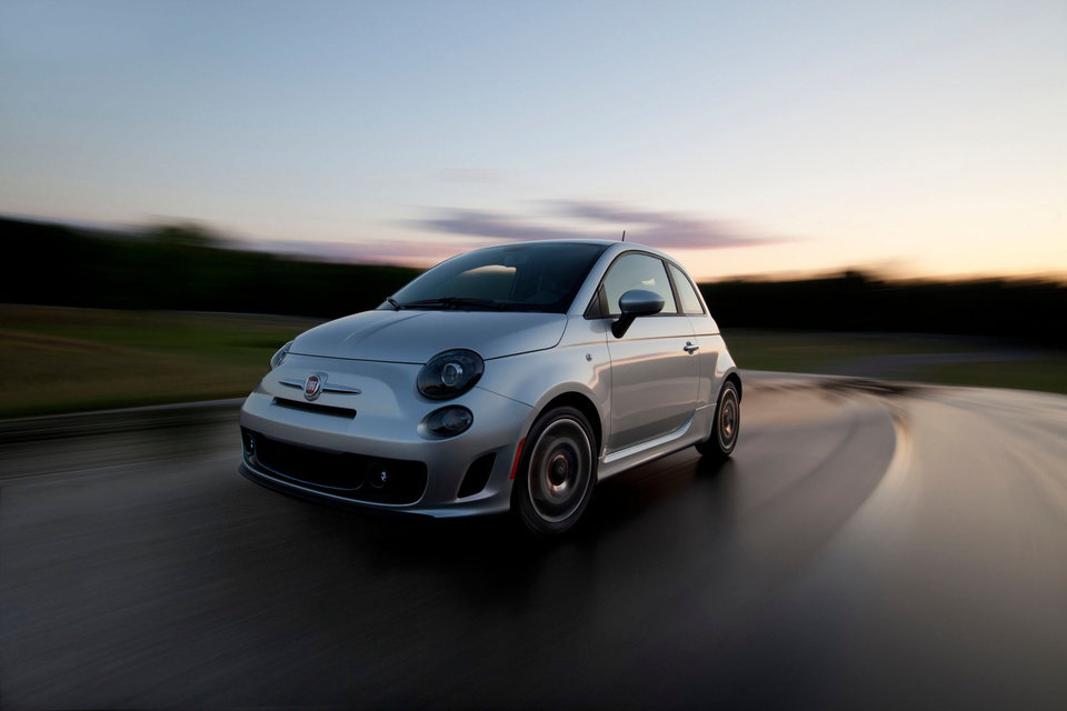 Photo -   This undated image provided by Chrysler shows the New 2013 Fiat 500 Turbo. Chrysler Group LLC said Tuesday, Oct. 2, 2012, that its September U.S. sales rose 12 percent, crediting strong demand for new models, low interest rates and a stable U.S. economy. (AP Photo/Chrysler)