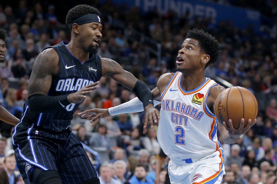 Photo - Oklahoma City's Shai Gilgeous-Alexander (2) moves past Orlando's Terrence Ross (8) during an NBA basketball game between the Oklahoma City Thunder and the Orlando Magic at Chesapeake Energy Arena in Oklahoma City, Tuesday, Nov. 5, 2019. [Bryan Terry/The Oklahoman]