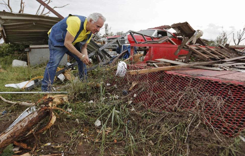 Mack James tries to salvage items from his garage after his home was destroyed by the tornado that hit the area near 149th and Drexel on Monday, May 20, 2013 in Oklahoma City, Okla.  Photo by Chris Landsberger, The Oklahoman
