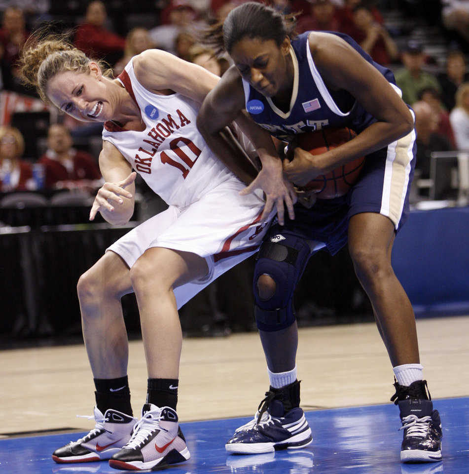 Carlee Roethlisberger (10) and Chelsea Cole fight for the ball in the second half of the NCAA women's basketball tournament game between the University of Oklahoma and Pittsburgh at the Ford Center in Oklahoma City, Okla. on Sunday, March 29, 2009. 