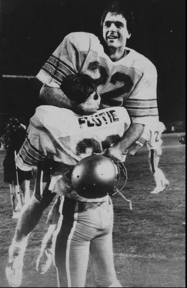 Photo - ** FILE **    COLLEGE FOOTBALL: Boston College quarterback Doug Flutie rejoices in his brother Darren's arms after defeating the Miami Hurricanes with a last second touchdown pass to defeat Miami, 47-45  in this Nov. 23, 1984 photo in Miami.  Twenty years after Doug Flutie threw one of the most famous passes in college football history, Boston College is having another memorable season. (AP Photo)