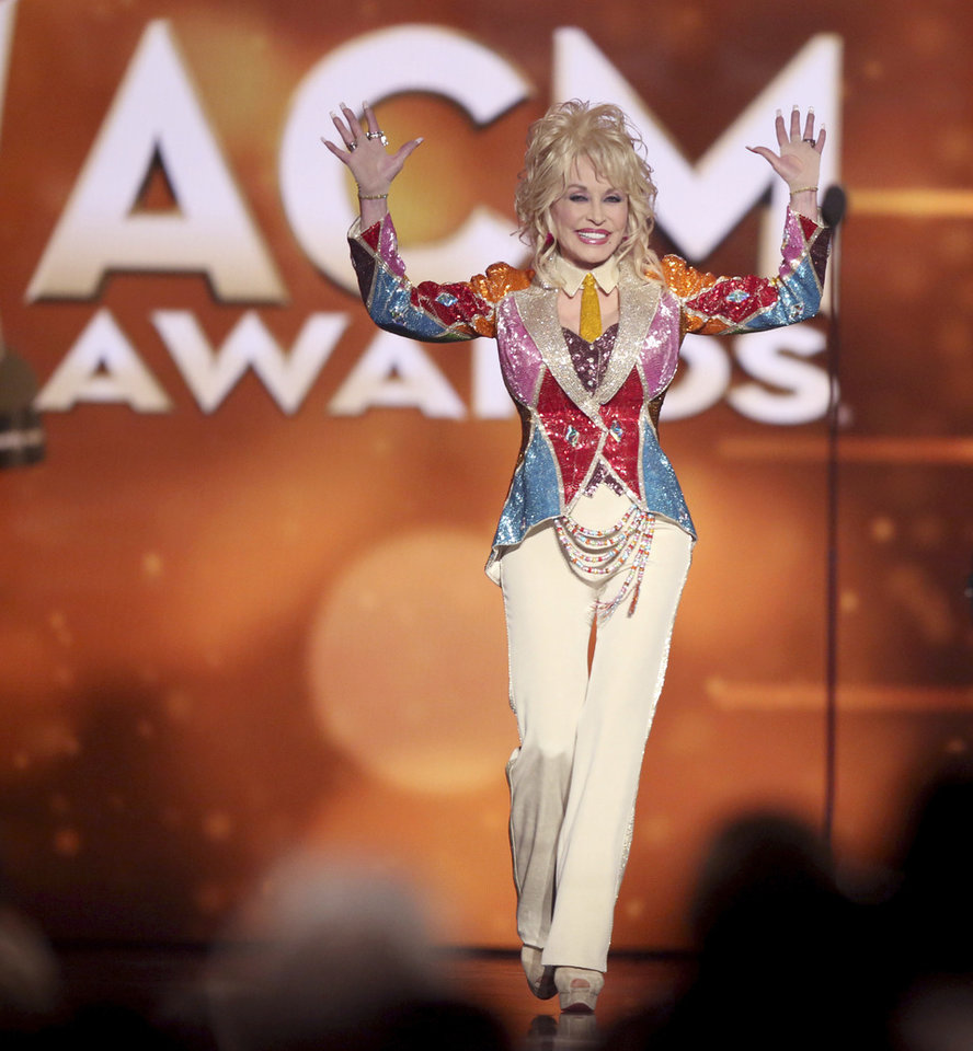 Photo - FILE - This April 3, 2016 file photo shows Dolly Parton walking on stage to accept the Tex Ritter award at the 51st annual Academy of Country Music Awards at the MGM Grand Garden Arena in Las Vegas. The 52nd annual Academy of Country Music Awards will air on CBS on Sunday, April 2, 2017, from T-Mobile Arena in Las Vegas. (Photo by Matt Sayles/Invision/AP, File)