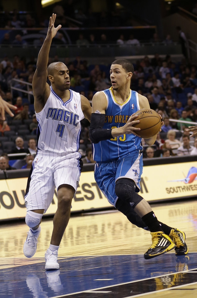 New Orleans Hornets' Austin Rivers, right, drives with the ball around Orlando Magic's Arron Afflalo (4) during the first half of an NBA basketball game on Wednesday, Dec. 26, 2012, in Orlando, Fla. (AP Photo/John Raoux)