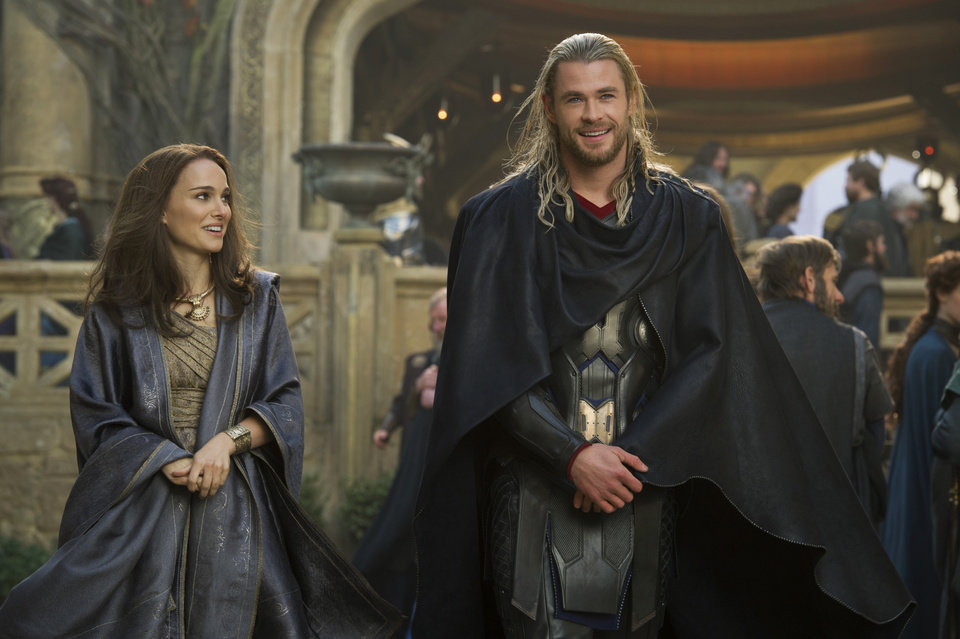 FILE - This publicity photo released by Walt Disney Studios and Marvel shows Natalie Portman, left, as Jane Foster and Chris Hemsworth as Thor, in Marvel\'s