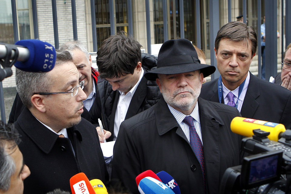 Lawyer Luka Misetic, left, and Gotovina's American lawyer, Greg Kehoe, second right, talk to the media outside the Yugoslav war crimes tribunal(ICTY) in The Hague, Netherlands, Friday, Nov. 16, 2012. The ICTY appeals judges overturned the convictions of two Croat generals on Friday for crimes against humanity and war crimes committed against Serb civilians in a 1995 military blitz. The decision, by a 3-2 majority in the five judge appeals chamber, is one of the most significant reversals in the court's 18-year history and overturns a verdict that dealt a blow to Croatia's self-image as a victim of atrocities, rather than a perpetrator, during the Balkan wars in the 1990s. (AP Photo/Bas Czerwinski)