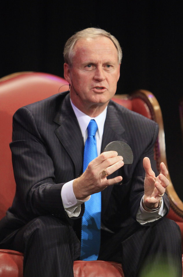 Photo - John Richels, Devon Energy president, holds up a piece of oil producing shale during a session titled