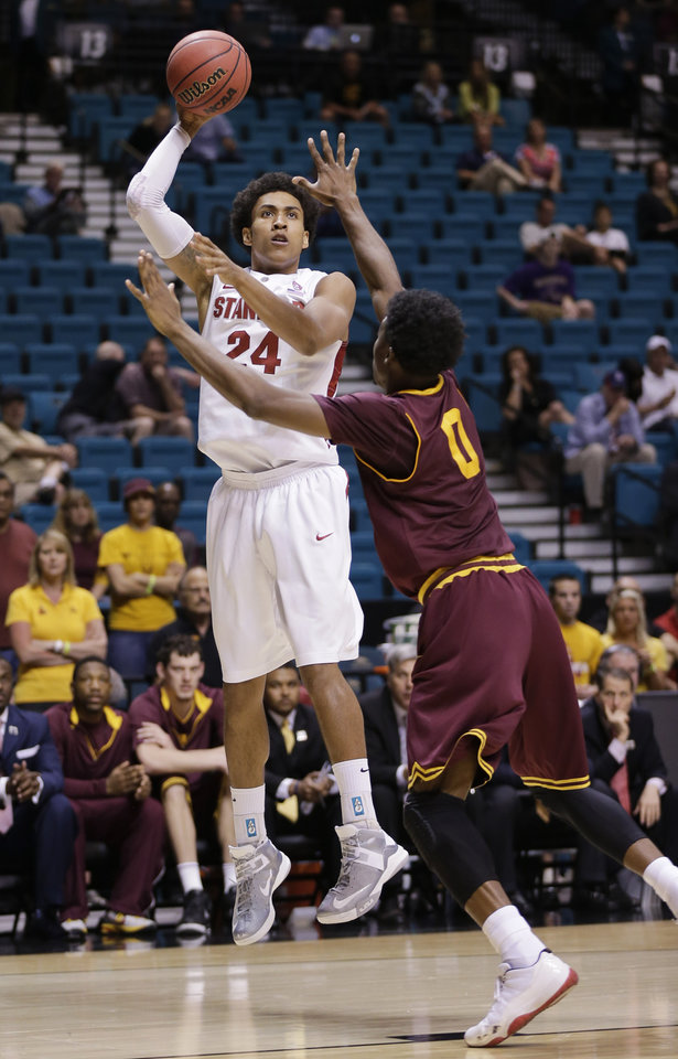 Photo - Stanford's Josh Huestis shoots over Arizona State's Carrick Felix during a Pac-12 tournament NCAA college basketball game, Wednesday, March 13, 2013, in Las Vegas. (AP Photo/Julie Jacobson)