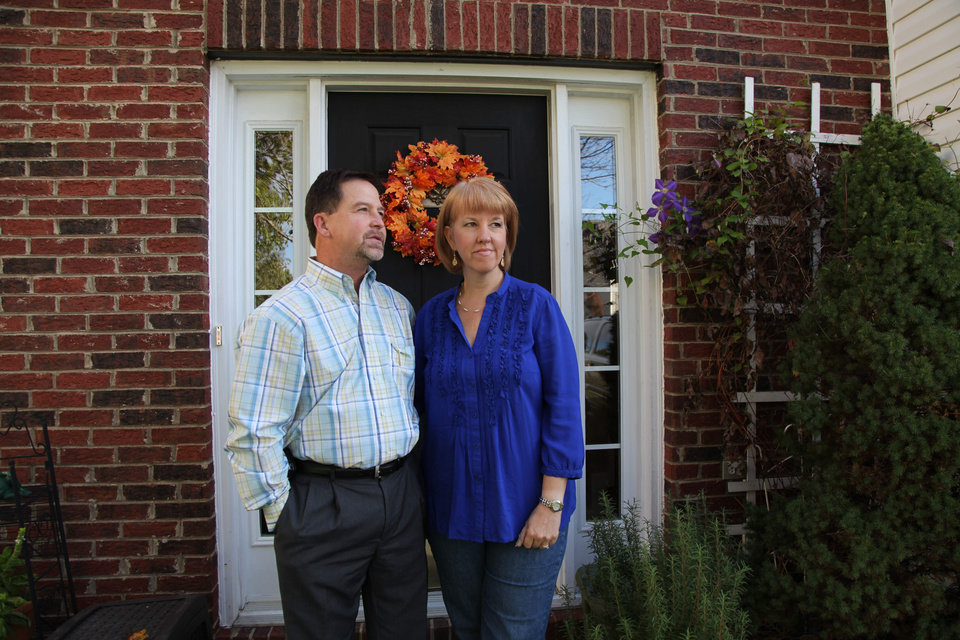 Photo -   In this Oct. 19, 2012, photo, Ray and Candice Arvin pose outside their home in Charlotte, N.C. Romney supporter, Arvin used to own a small business with five employees, selling equipment to power companies, but he went out of business in 2009. He's now a salesman for another equipment company. Polls consistently find that the economy is the top concern of voters, and Romney tends to get an edge over Obama when people are asked who might do better with it. Whether that truly drives how Americans vote is a crucial question for Election Day. (AP Photo/Robert Ray)