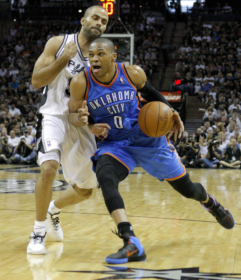 Oklahoma City\'s Russell Westbrook (0) drives past San Antonio\'s Tony Parker (9) during Game 1 of the Western Conference Finals between the Oklahoma City Thunder and the San Antonio Spurs in the NBA playoffs at the AT&T Center in San Antonio, Texas, Sunday, May 27, 2012. Photo by Bryan Terry, The Oklahoman