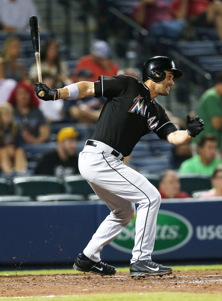 Photo - Miami Marlins first baseman Garrett Jones (46) drives in the game-winning run with a two-run single in the 10th inning of a baseball game against the Atlanta Braves  in Atlanta, Monday, July 21, 2014. Miami won 3-1. (AP Photo/John Bazemore)
