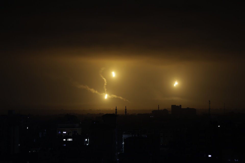 Photo - Flares light up the sky over Gaza City, Friday Aug. 1, 2014. Israeli Prime Minister Benjamin Netanyahu said Thursday that Israel will destroy Hamas' tunnel network in the Gaza Strip designed for deadly attacks inside Israel,