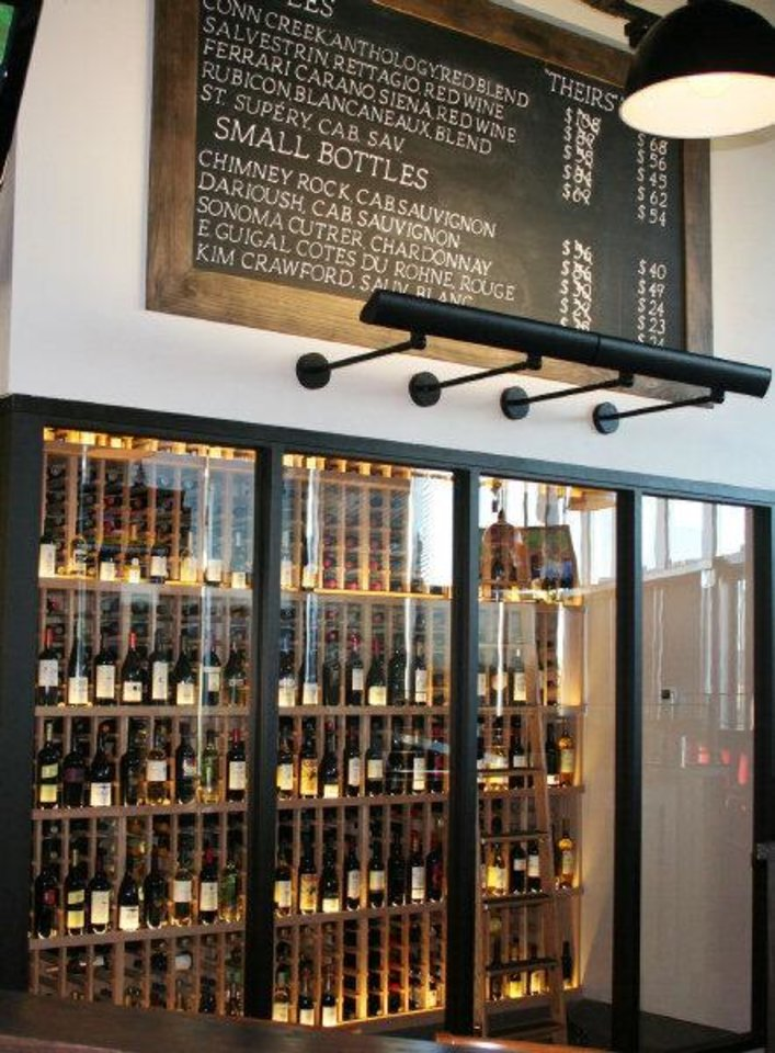Photo - The wine list at Upper Crust features about 70  choices with an extensive collection of splits. Photo by Dave Cathey.