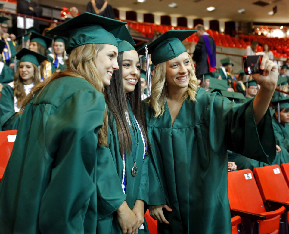 Friends Shelby Chamney, Kaitlin Speer, and Ciara Toma pose for a self-portrait before graduation ceremonies for Norman North High School at the Lloyd Noble Center on Thursday, May 24, 2012, in Norman, Okla.  Photo by Steve Sisney, The Oklahoman