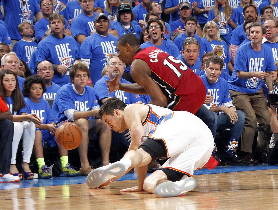 Oklahoma City's Nick Collison (4) and Miami's Mario Chalmers (15) go after a loose ball during Game 1 of the NBA Finals between the Oklahoma City Thunder and the Miami Heat at Chesapeake Energy Arena in Oklahoma City, Tuesday, June 12, 2012. Photo by Chris Landsberger, The Oklahoman