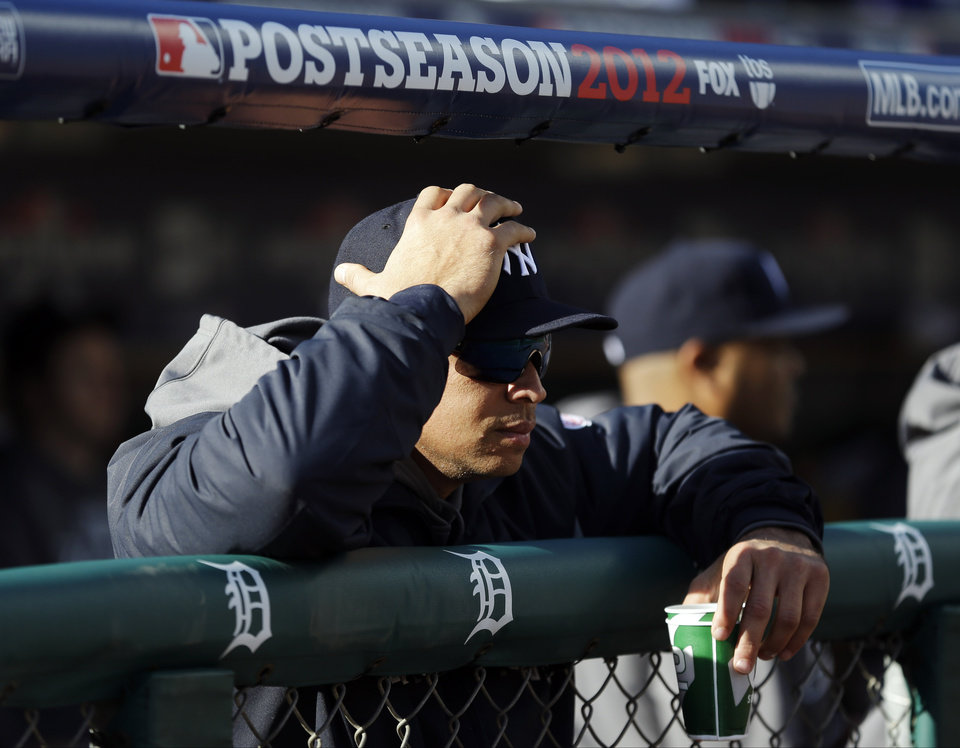 Photo -   New York Yankees' Alex Rodriguez watches Game 4 of the American League championship series against the Detroit Tigers Thursday, Oct. 18, 2012, in Detroit. (AP Photo/Paul Sancya )