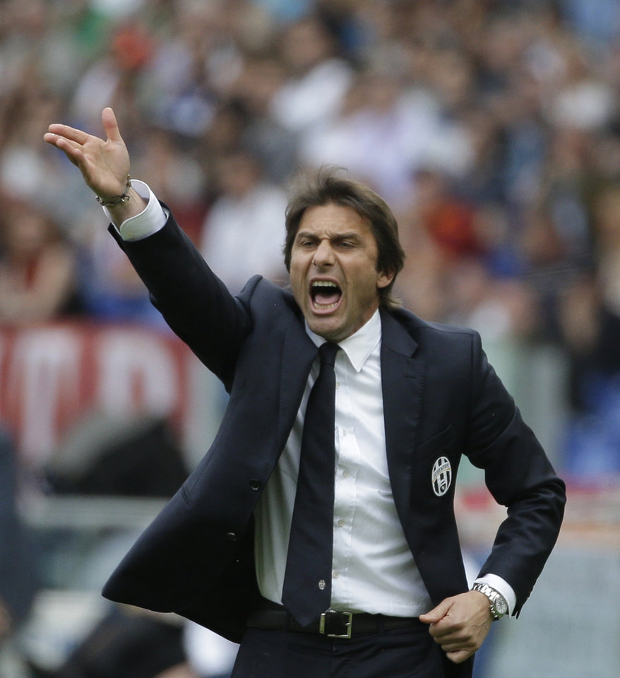 Photo - Juventus coach Antonio Conte shouts during an Italian Serie A soccer match between Roma and Juventus at Rome's Olympic stadium, Sunday, May 11, 2014. (AP Photo/Alessandra Tarantino)