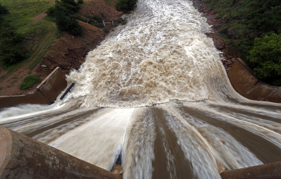 Photo - Water is released from the Lawton Dam into Medicine Creek in Medicine Park, Okla., Sunday, May 24, 2015. Photo by Sarah Phipps, The Oklahoman
