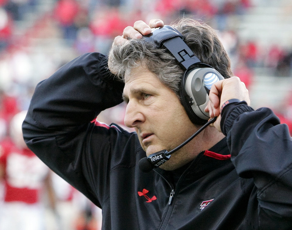 Photo - Texas Tech University head coach Mike Leach adjusts his head set in the final minutes of an NCAA college football game against Nebraska, in Lincoln, Neb., Saturday, Oct. 17, 2009. Texas Tech beat Nebraska 31-10.(AP Photo/Nati Harnik) ORG XMIT: NENH111