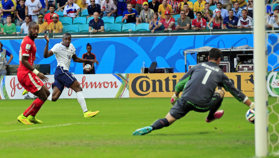 Photo - France's Blaise Matuidi watches as his kick goes past Switzerland's goalkeeper Diego Benaglio to score his side's second goal during the group E World Cup soccer match between Switzerland and France at the Arena Fonte Nova in Salvador, Brazil, Friday, June 20, 2014. (AP Photo/Bernat Armangue)