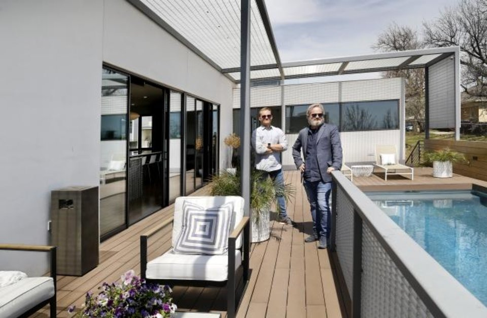 Photo -  Sean Cobb, left, and architect Brian Fitzsimmons at  the swimming pool on the second-level deck of the Cobb home, one  of seven stops on the April 13 AIA Central Oklahoma Architecture Tour. [JIM BECKEL/THE OKLAHOMAN]