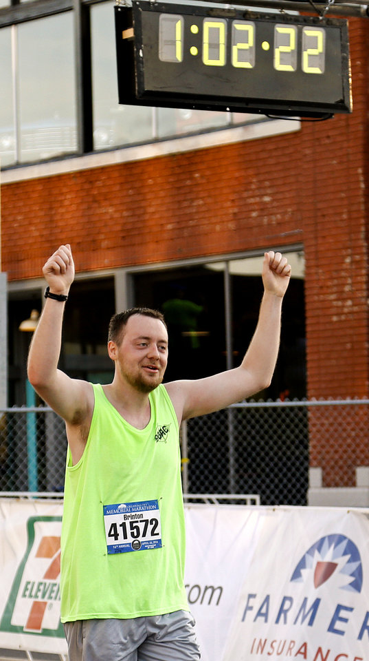 Photo - Brinton Callaghan celebrates finishing the 5K during the Oklahoma Memorial Marathon in Oklahoma City, Okla. on Sunday, April 24, 2016.   Photo by Chris Landsberger, The Oklahoman