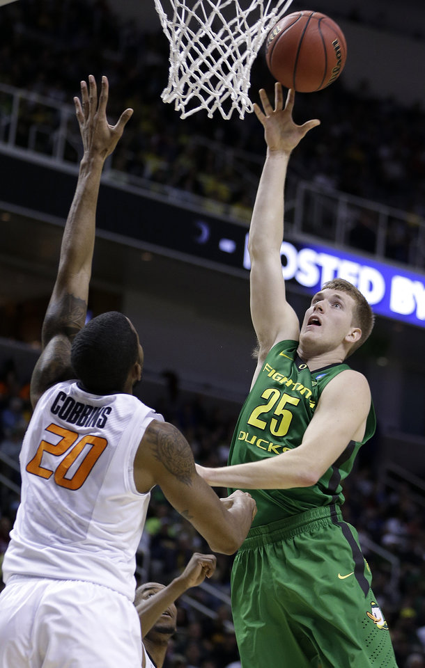 Oregon forward E.J. Singler (25) shoots over Oklahoma State forward Michael Cobbins (20) during the first half of a second-round game in the NCAA college basketball tournament in San Jose, Calif., Thursday, March 21, 2013. (AP Photo/Ben Margot) ORG XMIT: SJA127