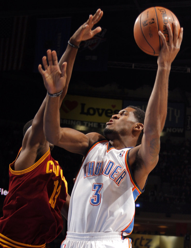 Photo - Oklahoma City's Perry Jones III (3) shoots over Cleveland's Tristan Thompson (13) during the NBA basketball game between the Oklahoma City Thunder and the Cleveland Cavaliers at the Chesapeake Energy Arena, Sunday, Nov. 11, 2012. Photo by Sarah Phipps, The Oklahoman