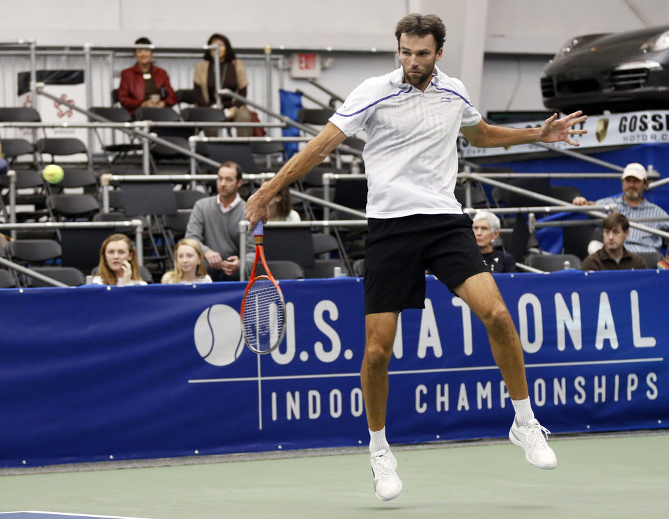 Photo - Ivo Karlovic, of Croatia, hits a backhand return to Kei Nishikori, of Japan, in the singles final at the U.S. National Indoor Tennis Championships on Sunday, Feb. 16, 2014, in Memphis, Tenn. (AP Photo/Rogelio V. Solis)