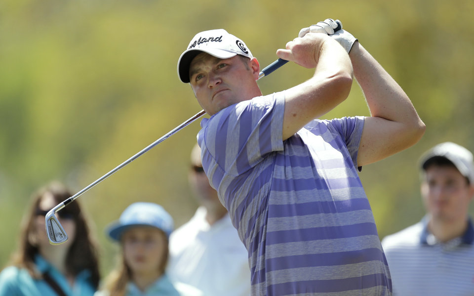 Photo - Jason Kokrak tees off on the second hole during the final round of the Valspar Championship golf tournament at Innisbrook Sunday, March 16, 2014, in Palm Harbor, Fla. (AP Photo/Chris O'Meara)