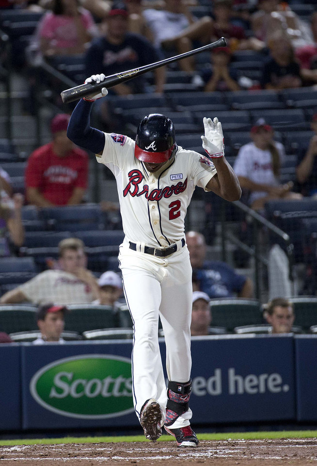 Photo - Atlanta Braves' B.J. Upton reacts after striking out in the third inning of a baseball game against the Washington Nationals on Saturday, Aug. 9, 2014, in Atlanta. (AP Photo/John Bazemore)