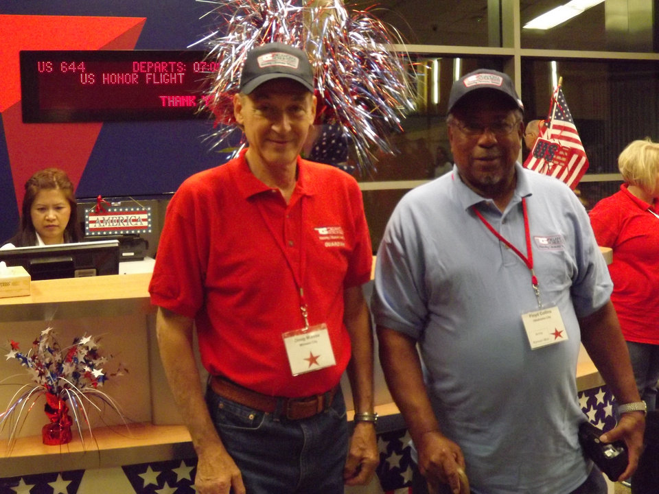 Photo -  Volunteer Doug Miesse with Korea and Vietnam Veteran Floyd Collins waiting for an Honor Flight departure from Oklahoma City to Washington, D.C. [PHOTO PROVIDED]