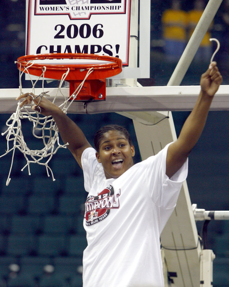 Photo - Oklahoma's Courtney Paris cuts the net after beating Baylor 72-61 to win the Big 12 Women's Championship basketball game, Saturday, March 11, 2006, in Dallas. (AP Photo/Matt Slocum)