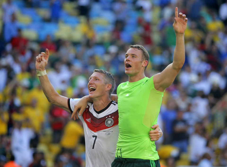 Photo - Germany's Bastian Schweinsteiger, left, and Germany's goalkeeper Manuel Neuer celebrate after the World Cup quarterfinal soccer match between Germany and France at the Maracana Stadium in Rio de Janeiro, Brazil, Friday, July 4, 2014. Germany won the match 1-0. (AP Photo/David Vincent)