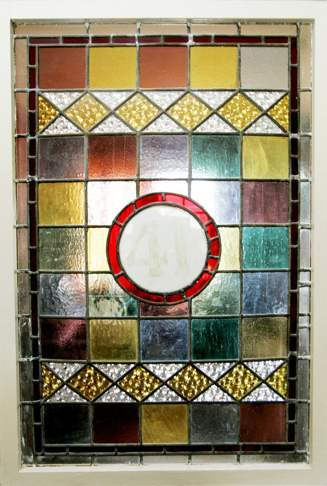 Photo - A stained-glass window from an old drug store is on the upstairs landing of the Symphony Designers Show House, 431 NW 17. PHOTO BY STEVE GOOCH, THE OKLAHOMAN