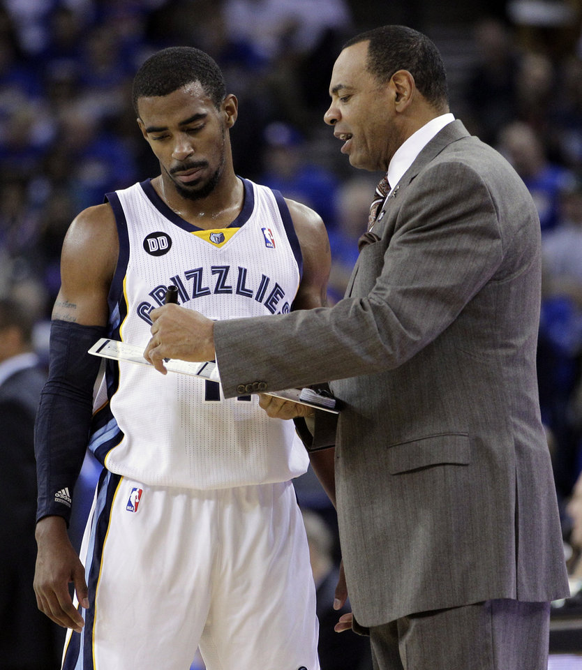 Photo -   Memphis Grizzlies' Mike Conley, left, speaks with coach Lionel Hollins during the first half of an NBA basketball game against the Golden State Warriors Friday, Nov. 2, 2012, in Oakland, Calif. (AP Photo/Ben Margot)