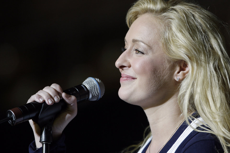 Photo - FILE - In this undated file photo, country singer Mindy McCready performs in Nashville, Tenn. McCready, who hit the top of the country charts before personal problems sidetracked her career, died Sunday, Feb. 17, 2013. She was 37. (AP Photo/Mark Humphrey, File)