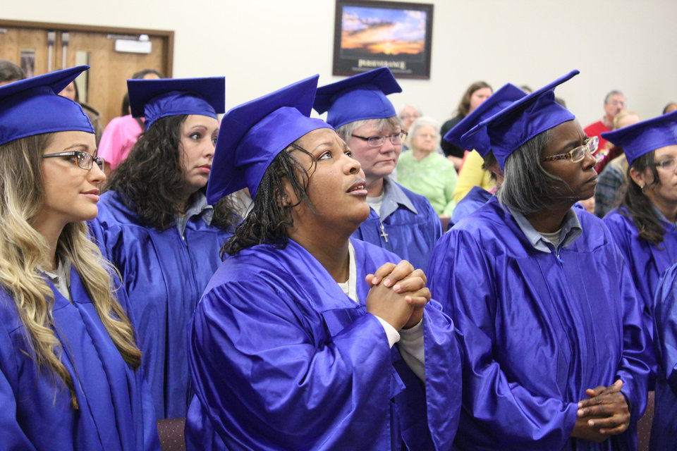 Kimberly Coulter, Kimberly Chevenert and Latina Broussard are seen Thursday during the Victory Bible Institute graduation ceremony at the Eddie Warrior Correctional Facility in Taft. PHOTO BY NATHAN POPPE, OKLAHOMA WATCH