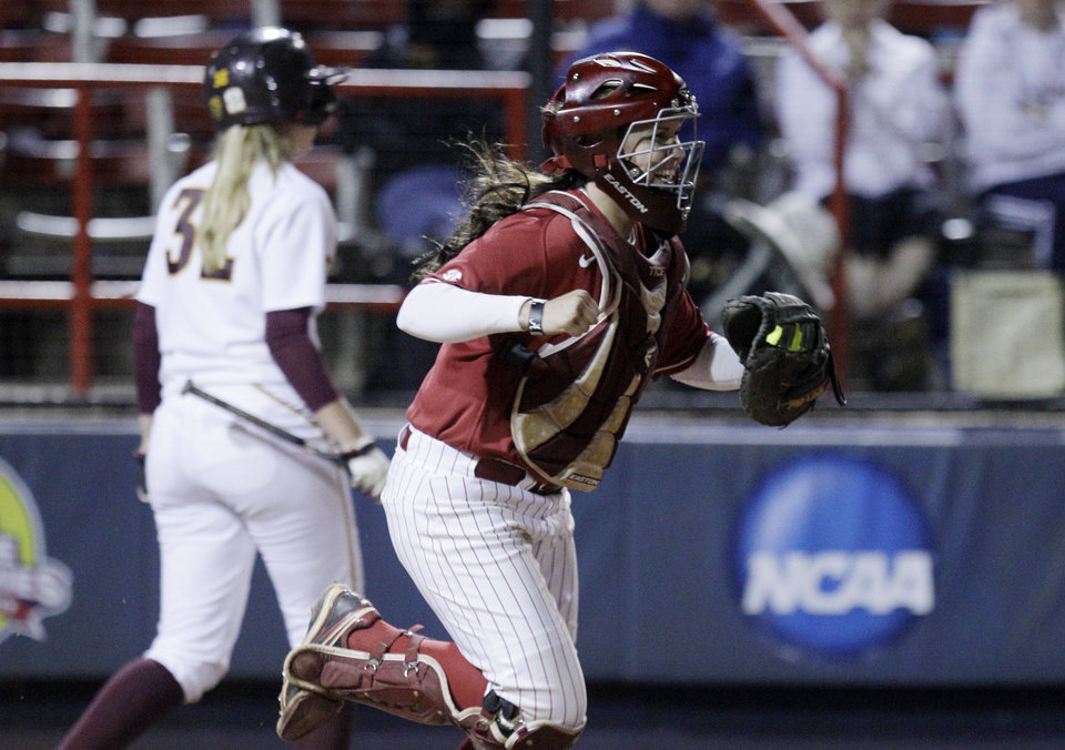 Photo - Alabama catcher Kendall Dawson, right, rushes out to celebrate with her teammates as Arizona State's Haley Steele (32) walks back to the dugout after striking out in the seventh inning to end an NCAA Women's College World Series softball game in Oklahoma City, Friday, June 1, 2012. Alabama won 2-1.(AP Photo/Sue Ogrocki) ORG XMIT: OKSO116